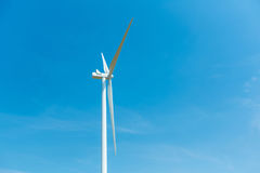 Wind turbine over a deep blue sky. Renewable energy concept Royalty Free Stock Photo