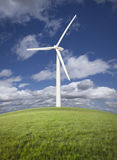 Wind Turbine Over Grass Field, Sky and Clouds. Single Wind Turbine Over Grass Field, Dramatic Sky and Clouds Royalty Free Stock Image
