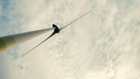 Wind turbine over stormy cloudy sky using renewable energy to generate electrical power. stock video
