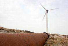 Wind Turbine and pipeline Royalty Free Stock Image