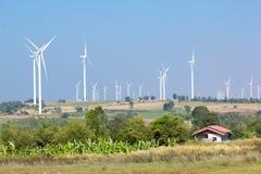 Wind turbine power generator. Farm Stock Image