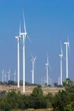 Wind turbine power generator. Farm Stock Photo