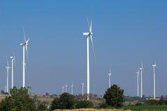 Wind turbine power generator. Farm Stock Photography