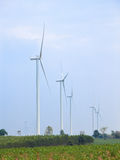 Wind turbine power generator. In green field Royalty Free Stock Images