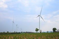 Wind turbine power generator. In green field Stock Photography