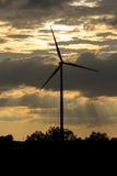 Wind turbine power generator at sunset. Wind turbine power generator farm at sunset Stock Photo