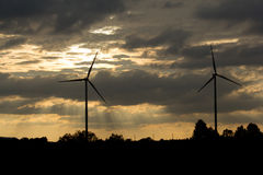 Wind turbine power generator at sunset. Wind turbine power generator farm at sunset Royalty Free Stock Photography