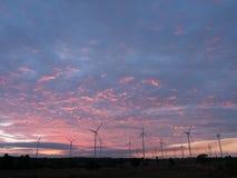Wind turbine power generator at sunset. Light Stock Image