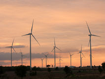 Wind turbine power generator at sunset. Light Stock Photos