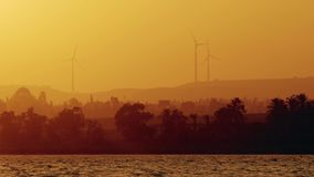 Wind turbine power generator at twilight. Cyprus stock video footage