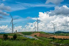 Wind turbine power generators on mountain Royalty Free Stock Photo