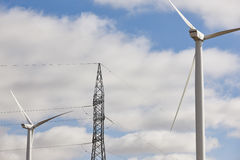 Wind turbine and power line. Clean alternative renewable energy. Stock Images
