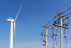 Wind turbine and power lines transporting Stock Photo