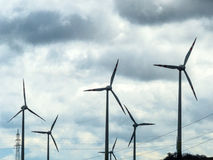 Wind turbine and power poles Royalty Free Stock Photography
