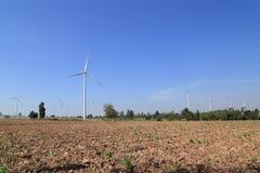 Wind turbine producing alternative energy Royalty Free Stock Images