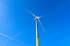 Wind turbine producing renewable energy Royalty Free Stock Images