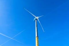 Wind turbine producing renewable energy Royalty Free Stock Images