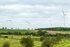 Wind turbine renewable energy source summer landscape with clear Stock Images