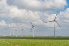 Wind turbine, renewable energy sources. Landscape with windmills on field, alternative energy, wind turbine, renewable energy sources Stock Photo