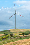 Wind turbine on a rural hilltop Royalty Free Stock Images