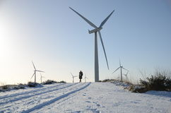 Wind Turbine in rural Scotland. Winter snow and alternative energy generation in a wind farm in the countryside of Scotland stock image