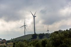 Wind Turbine`s on The Top of a Hill. In a Cloudy Day stock photos