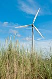 Wind turbine and sand dunes Stock Photo
