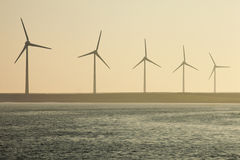 Wind turbine at the shore in the Netherlands Royalty Free Stock Photography