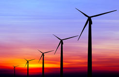 Wind turbine silhouette on colorful sunset Stock Images