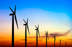 Wind turbine silhouette on colorful sunset Royalty Free Stock Photo
