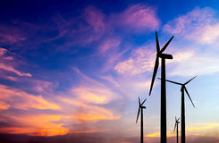 Wind turbine silhouette on colorful sunset Stock Photo