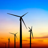 Wind turbine silhouette on colorful sunset Royalty Free Stock Photos