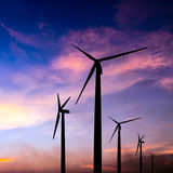 Wind turbine silhouette on colorful sunset Stock Image