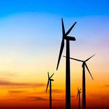 Wind turbine silhouette on colorful sunset Royalty Free Stock Images