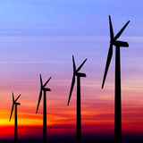 Wind turbine silhouette on colorful sunset Stock Photography