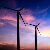 Wind turbine silhouette on colorful sunset Stock Photos
