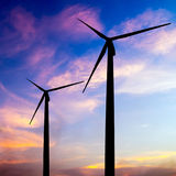 Wind turbine silhouette on colorful sunset Royalty Free Stock Photography