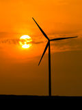 Wind turbine silhouette with sunlight Stock Images