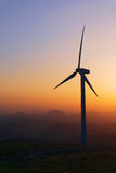 Wind turbine silhouette at sunset Stock Photography