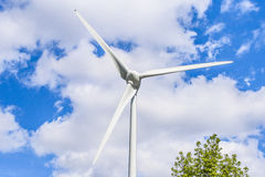 Wind turbine in the sky blue clouds Royalty Free Stock Image