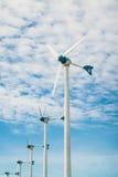 Wind turbine with sky cloud sun daylight Stock Photos