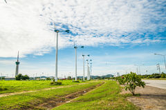 Wind turbine with sky cloud sun daylight Royalty Free Stock Image