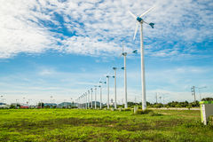 Wind turbine with sky cloud sun daylight Royalty Free Stock Images