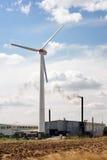 Wind turbine by smoking pipe Royalty Free Stock Photo
