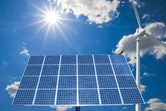Wind turbine and solar panel Stock Photo