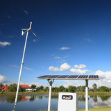 Wind turbine and solar panel. Royalty Free Stock Images