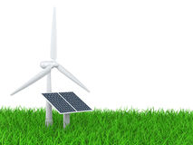Wind turbine and solar panel on a grass field Royalty Free Stock Photography