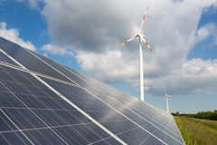 Wind turbine with solar panels at energy park. A wind turbine with solar panels at energy park Stock Image