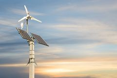 Wind turbine with solar panels on pillar Royalty Free Stock Photos
