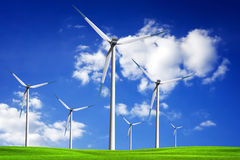 Wind turbine on spring field Stock Image
